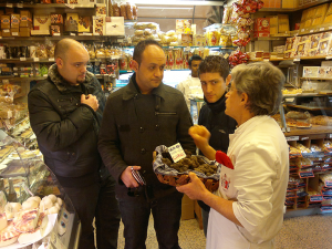 Caption. Signor Angelo Volpetti explaining the merits of his black Alba truffles to, from l to r, chefs Ricardo Bongailas ( Vecchia Napoli), Andre' Spiteri ( The Chophouse) and Keith Zammit ( Gululu ).